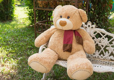 Big bear doll sit on the chair in garden Stock Photo