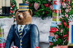 Big bear figure in front of Christmas tree Royalty Free Stock Images