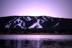 Big Bear Lake Ski Mountain. Big Bear Lake California ski mountain over lake at dusk Royalty Free Stock Image