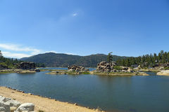 Big Bear Lake. Is a small city in San Bernardino County, California, located in the San Bernardino Mountains along the south shore of , and surrounded by the stock images