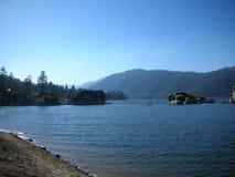 Big bear lake, water, rocks and pine trees royalty free stock photos