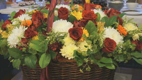 Big beautiful basket of flowers is on anniversary. Big beautiful basket of flowers is on the anniversary. Close-up stock footage