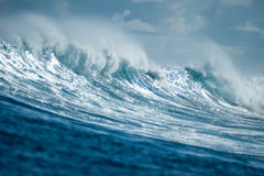 Big beautiful blue wave. Scenery of big beautiful blue wave and white foam in the ocean Stock Photography
