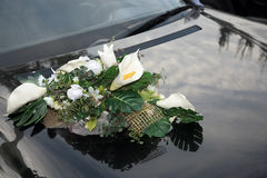 Big beautiful bouquet on the hood of the car Royalty Free Stock Image