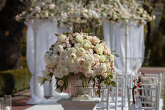Big beautiful bouquet of in a vase . Set up for the wedding ceremony. Royalty Free Stock Images
