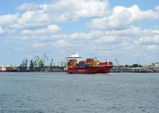 Red cargo ship - Containers in Klaipeda port, Lithuania Royalty Free Stock Photos