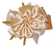 Big beautiful cream-colored bow isolated on white Stock Images