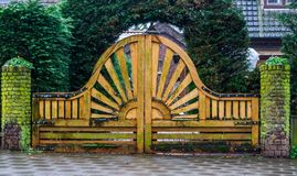Big And Beautiful Wooden Garden Gate With A Sun Pattern