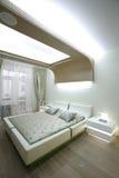 Big bed in bedroom. Big white bed in bedroom Stock Photo