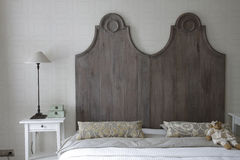 Big bed in gray color. Big bed with high headboard in gray color Stock Photo