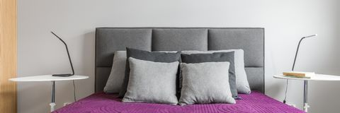 Big bed with grey pillows royalty free stock photo
