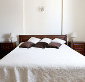 Big bedroom in brown and beige colors Stock Images