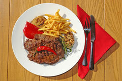 Big beef Steak with garnish and mojito Royalty Free Stock Photos