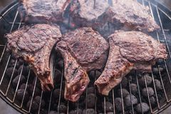 Big beef steaks on bone grilled  barbecue Stock Images