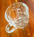 A big beer glass on table Royalty Free Stock Image