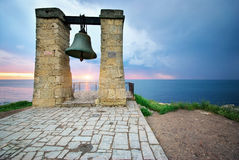 Big bell on sea shore Stock Image