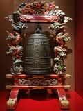 Big bell in support decorated with traditional Chinese dragons Stock Photo