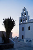 Big bell tower of Panagia church in Oia village after sunset at Santorini island Royalty Free Stock Images