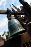 Big bell at wooden temple in Mandalay Royalty Free Stock Photos