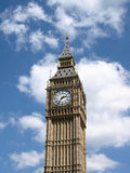 Big Ben. The clock tower of the UK Houses of Parliament in London, set against a blue cloudy sky Stock Image