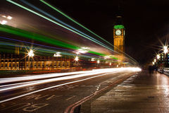 Big Ben. This photo was taken at night, during rainy day from south side of Thames river. The view includes moving cars and buses, Big Ben and Westminster Royalty Free Stock Photography