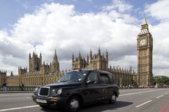 Big Ben. LONDON - MAY 31: A London Black Cab on Westminister Bridge on May 31, 2011. The Black Cabs are regulated by Transport For London and are the only Stock Image