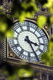 Big Ben. A view of the famous clock tower in London with tree leaves in the foreground Royalty Free Stock Photography