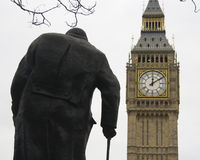 Big ben. Big bien tower with wiston churchill's statue Stock Images