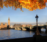 Big Ben with autumn leaves in London, England. Big Ben in London with bridge , England Royalty Free Stock Photos