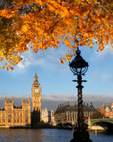 Big Ben with autumn leaves in London, England. Big Ben in London with bridge , England Royalty Free Stock Image