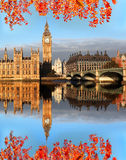Big Ben with autumn leaves in London, England. Big Ben in London with bridge , England Stock Photo