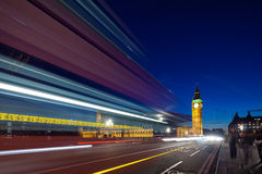 Big Ben behind light beams at twilight time, London, UK Royalty Free Stock Image