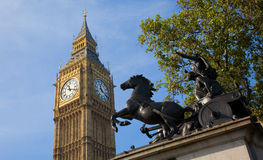 Big Ben and Boadicea. The statue of Queeen Boadicea (Boudica) with St Stephen's Tower (Big Ben) in the background royalty free stock images