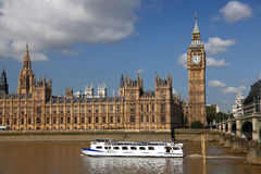 Big Ben with boat, London, UK. Big Ben with motor boat in Westminster, London, UK Stock Photography