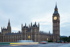 Big Ben and bridge in the early morning, car passing in London Royalty Free Stock Photos