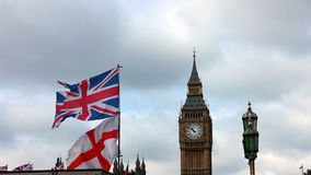 Big Ben with British flags waving in London stock video