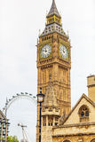 Big Ben. The clock of big ben displays the time very clearly, with the London Eye in the background royalty free stock photos