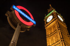 Big Ben Clock and London Underground station sign. LONDON – AUGUST 6: Big Ben Clock and London Underground station sign on August 6, 2013. The London Royalty Free Stock Image