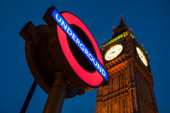 Big Ben Clock and London Underground station sign. LONDON – AUGUST 4: Big Ben Clock and London Underground station sign on August 4, 2013. The London Royalty Free Stock Photography