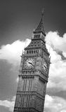 Big Ben Clock Tower. Black and white image of Big Ben clock tower in London, England, against dramatic clouds. Image has an added film grain effect Royalty Free Stock Images