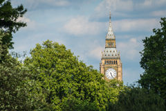 Big Ben Clock Tower in London England. The clock tower of the famous Big Ben of London England with trees in the foreground Royalty Free Stock Photo
