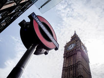 Big Ben clock tower with London underground sign. Against blue sky Stock Images
