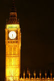 Big Ben clock tower at night. Scenic view of Big Ben clock tower on Palace of Westminster illuminated at night with black sky background and copy space, London Stock Images