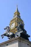 Big Ben clock tower and the Statue of queen Boudica. Big Ben clock tower (now renamed Elizabeth Tower) and the Statue of queen Boudica with chariot at the Houses Royalty Free Stock Image