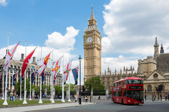 Big Ben Clock Tower and Westminster. Red bus in front of Big Ben Clock Tower and westminster abbey London, UK Stock Images