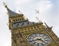 Big Ben. Close up of Big Ben clock tower with airplane flying past Stock Image