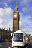 Big ben and coach. A white coach driving past big ben in London, with motion blur Royalty Free Stock Image