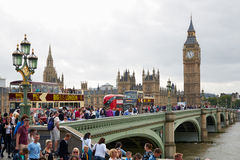 Big Ben and crowd of tourists and people in London. LONDON - AUGUST 4: Big Ben and crowd of tourists and people in a summer day on August 5, 2015 in London, UK Royalty Free Stock Images