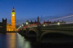 Big Ben in the dark. Big ben in the dark and red light of a bus on the bridge Royalty Free Stock Photography