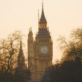 Big Ben at Dawn. Big Ben, seen from Hungerford Bridge, Close up in the evening glow Stock Photos